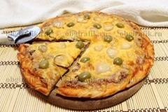 9. Подавать пиццу с тунцом слегка остуженной.